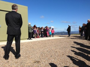 MetService Chief Executive Peter Lennox looks on as local school children sing at the opening ceremony.