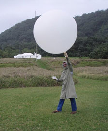 Releasing a weather balloon on Raoul Island (image courtesy of DOC: http://blog.doc.govt.nz/2010/10/01/its-not-all-weeds-here-on-raoul/)