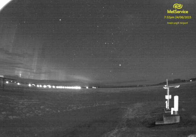 Meteorologists and astronomers both spend a lot of time looking at the sky—this webcam image from the weather station at Invercargill captured a lovely example of the Aurora Australis. In the foreground are the instruments used to measure cloud height and the type of weather.